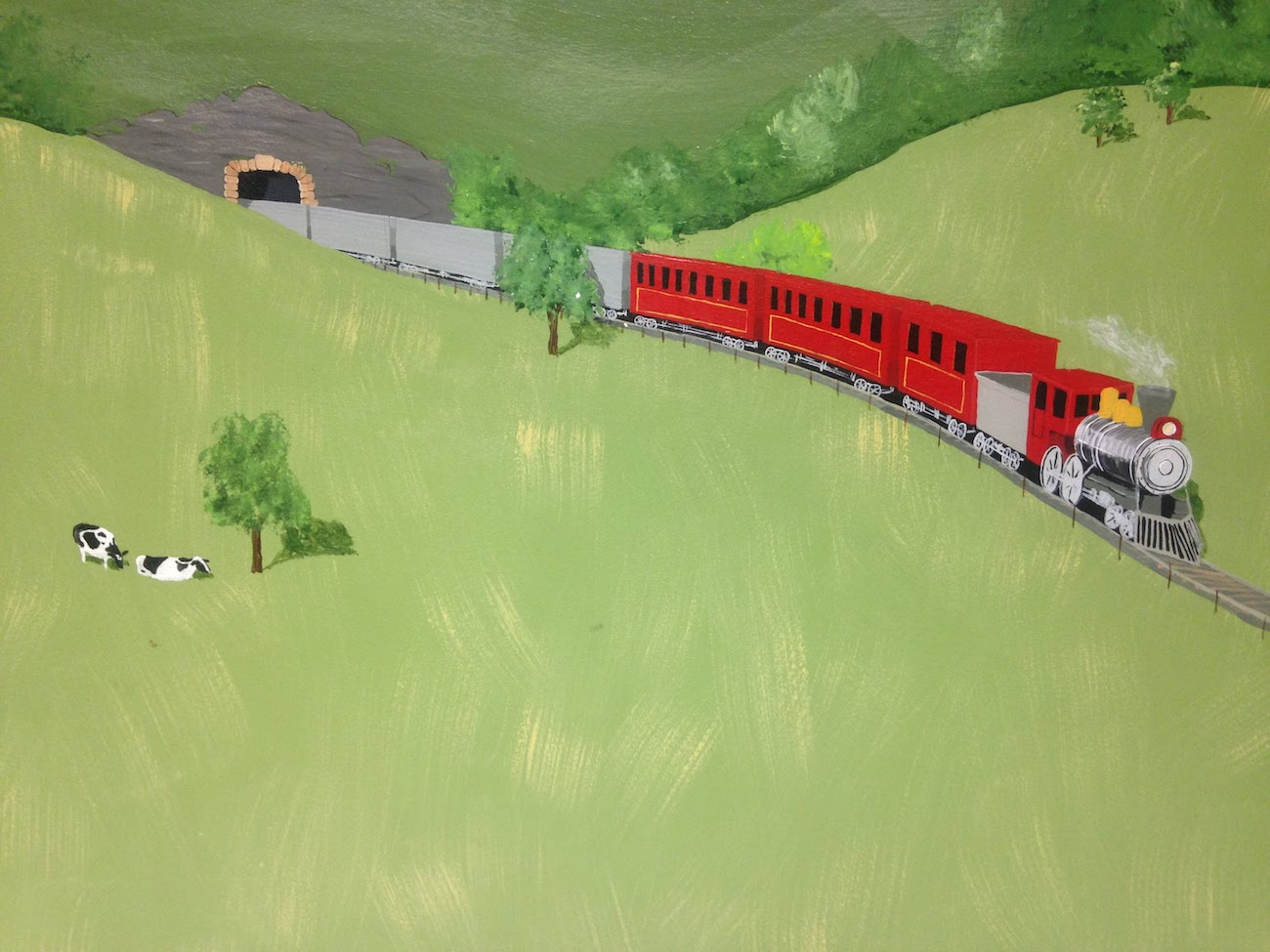 Mural of a red train coming out of a tunnel in a hillside in a field with cows.