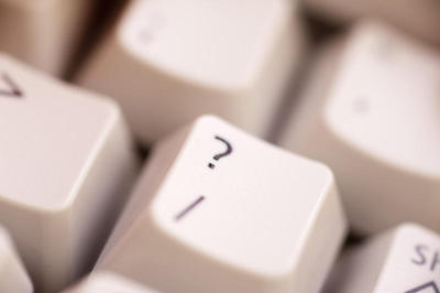 The question mark key on a computer keyboard.
